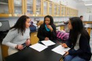 Precious Perez, Samantha Riche and Evelyn Martinez work on a lab project during their chemistry class at a high school in Chelsea, Massachusetts