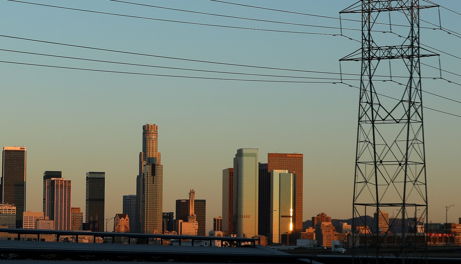 The skyline of L.A. is pictured under industrial power lines in the early morning light of Los Angeles, California, U.S., March 6, 2017.    REUTERS/Mike Blake - RTS11P52