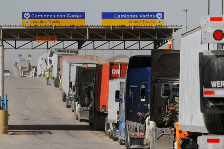 Trucks wait in a long queue for border customs control to cross into the U.S. at the Otay border crossing in Tijuana, Mexico, February 2, 2017. REUTERS/Jorge Duenes - RTX2ZF8Q
