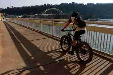A cyclist on the Fort Duquense Bridge in downtown Pittsburgh. Gene J. Puskar/AP