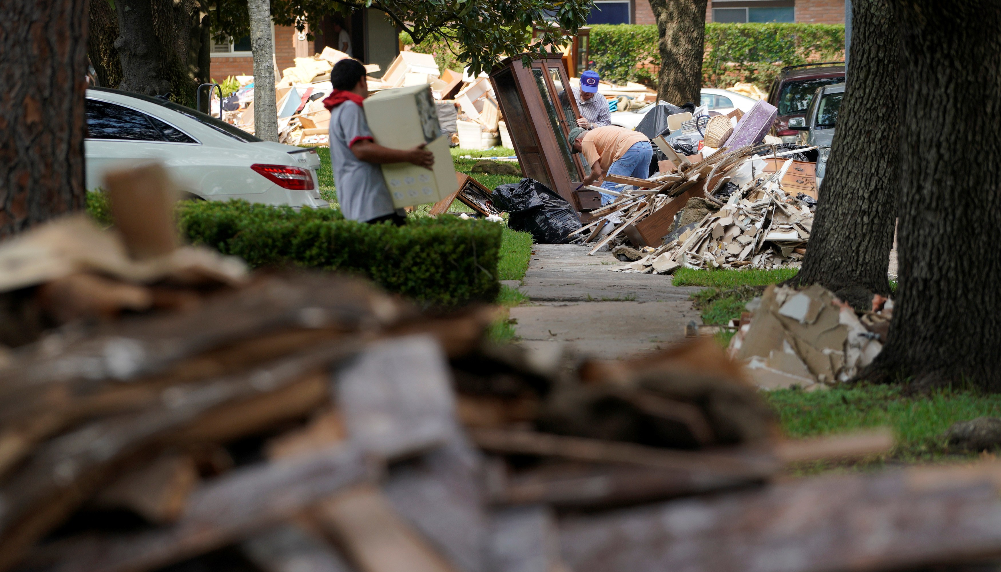 Photo: Giant mounds of trash from Hurricane Harvey flood damaged homes lines the sidewalks in Houston
