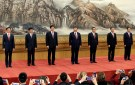 China's new Politburo Standing Committee members (L-R) Han Zheng, Wang Huning, Li Zhanshu, Xi Jinping, Li Keqiang, Wang Yang and Zhao Leji, line up as they meet with the press at the Great Hall of the People in Beijing, China October 25, 2017. REUTERS/Jason Lee - RC1BA9F5B410