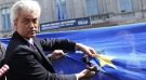 Dutch far-right Freedom Party (PVV) leader Geert Wilders cuts a star from the European Union flag during a demonstration in front of the EU Parliament in Brussels May 20, 2014.