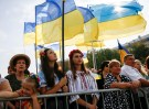 People attend a ceremony marking the Day of the State Flag, on the eve of the Independence Day, in Kiev, Ukraine, August 23, 2016. REUTERS/Gleb Garanich - S1BETXBGVWAB