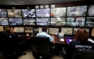 Municipal police officers watch screens in the video surveillance control room