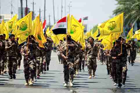 Iraqi Shi'ite Muslims from Hashid Shaabi (Popular Mobilization) march during a parade marking the annual al-Quds Day, or Jerusalem Day, in Baghdad, Iraq June 23, 2017. REUTERS/Khalid al Mousily