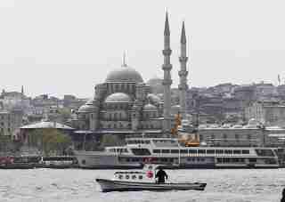 A fishing boat sails in the Golden Horn.