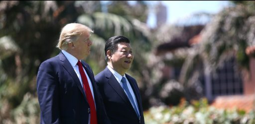 U.S. President Donald Trump (L) and China's President Xi Jinping walk along the front patio of the Mar-a-Lago estate after a bilateral meeting in Palm Beach, Florida, U.S., April 7, 2017. REUTERS/Carlos Barria - HP1ED471D8M65