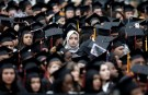Graduating students of the City College of New York sit together in their caps and gowns during the College's commencement ceremony in the Harlem.