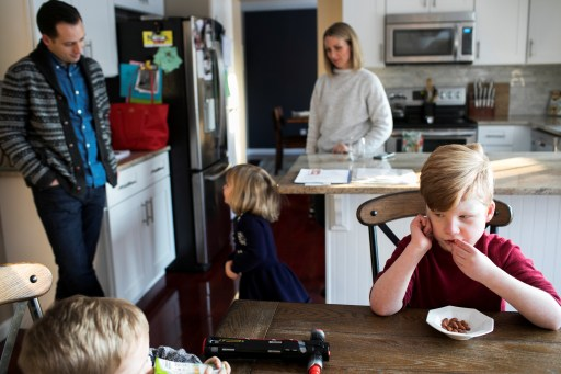 A family prepares lunch in the kitchen