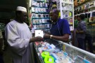 A customer views an iPad at a mobile phone market in Khartoum, Sudan July 3, 2017. REUTERS/Mohamed Nureldin Abdallah - RC17CEEEC800