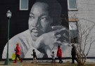 People gather to march in the annual parade down MLK Boulevard to honor Martin Luther King, in Chattanooga, Tennessee, U.S., January 16, 2017. REUTERS/Billy Weeks     TPX IMAGES OF THE DAY - RC162E1130E0