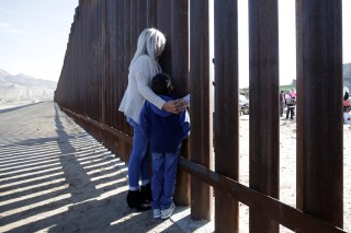 'Dreamers' speak with relatives during the 'Keep Our Dream Alive' binational meeting at a new section of the border wall on the U.S.-Mexico border.