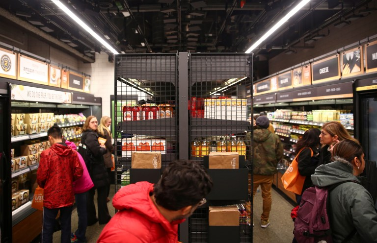 Rows of cameras installed in the ceiling keep track of customers as they browse the new Amazon Go in Seattle