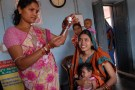 Community_health_worker_gives_a_vaccination_in_Odisha_state,_India_(8380317750)