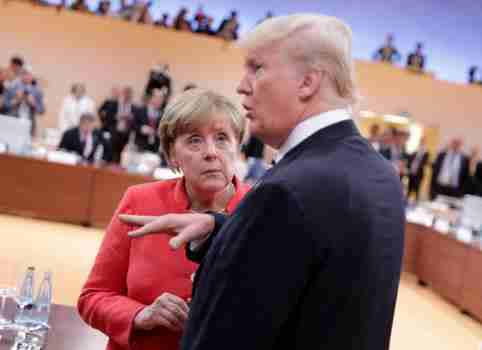 U.S. President Donald Trump talks to German Chancellor Angela Merkel before the first working session of the G20 meeting in Hamburg, Germany, July 7, 2017. REUTERS/Kay Nietfeld,Pool - RC1C9C45A9E0