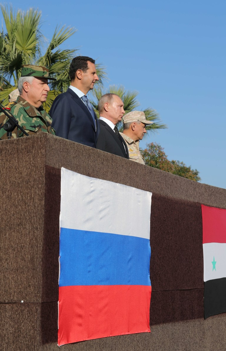 Russian President Vladimir Putin (2nd R), Defence Minister Sergei Shoigu (R) and Syrian President Bashar al-Assad (2nd L) visit the Hmeymim air base in Latakia Province, Syria December 11, 2017. Sputnik/Mikhail Klimentyev/Sputnik via REUTERS ATTENTION EDITORS - THIS IMAGE WAS PROVIDED BY A THIRD PARTY. TPX IMAGES OF THE DAY - RC1CC01C9AF0