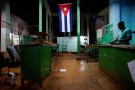 "A Cuban flag decorates a subsidised state store, or ""bodega"", where Cubans can buy basic products with a ration book they receive annually from the government, in downtown Havana"