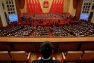 Delegates vote during third plenary session of National People's Congress in Beijing