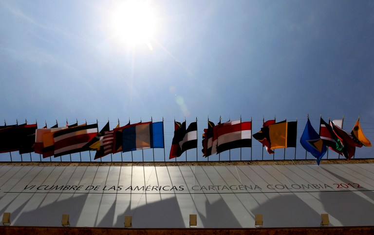 Flags of the countries of the Americas are seen at the entrance of the Centro de Convenciones in Cartagena