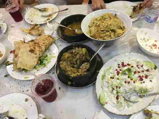 """After a walk through Jizan's central souk (market), another amazing Yemeni-style dinner. In the souk, a little boy begged me for change; locals dismissed him, telling me, """"huwa min Yemen"""" (""""he's from Yemen""""). A local told me that there is child trafficking into Jizan from Yemen. I did not see evidence of a major refugee inflow (e.g. homeless or begging families in the souk), and locals spoke of cross-border migration as a longstanding feature of life here—indeed, some locals trace their ancestry to Yemen."""