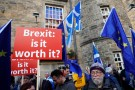 Protester hold placards, Saltires and EU flags during a demonstration to demand a vote on the Brexit deal between Britain and the European Union in Edinburgh, Scotland, March 24, 2018. REUTERS/Russell Cheyne - RC1F06F70EB0
