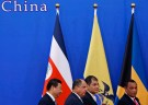 (L-R) China's President Xi Jinping, Costa Rica's President Luis Guillermo Solis, Ecuador's President Rafael Correa and Bahamas' Prime Minister Perry Christie walk after the opening ceremony of the 1st Ministerial Meeting of China-CELAC Forum at the Great Hall of the People in Beijing January 8, 2015. Xi pledged on Thursday $250 billion in investment in Latin America over the next 10 years, as part of a drive to boost Beijing's influence in a region long dominated by the U.S. Leaders of the Community of Latin American and Caribbean States, or CELAC - a bloc of 33 countries in the region that excludes the United States and Canada - gathered in Beijing for the first time for a two-day forum on Thursday.      REUTERS/Kim Kyung-Hoon (CHINA - Tags: POLITICS) - GM1EB180Y0Q01