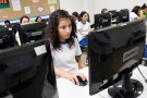 Children participate in a computing class at an Innova school in the outskirts of Lima