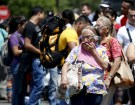 A Venezuelan woman covers her mouth as she makes her way to the line at the Simon Bolivar bridge to cross into Venezuela from Villa del Rosario village in Colombia August 25, 2015. The ongoing crisis on the border between Colombia and Venezuela should not be used for political point-scoring by leaders in either country ahead of elections in coming months, the Colombian government said on Tuesday.  REUTERS/Jose Miguel Gomez - GF10000182743