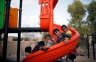 Yazidis children play in a playground in Sinjar region, Iraq August 2, 2017. Picture taken August 2, 2017. REUTERS/Suhaib Salem - RC119B0E1A00