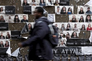 A student walks by a college notice board on campus at Yale University where more than 1,000 students, professors and staff at gathered to discuss race and diversity.
