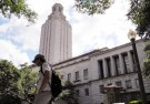 A student walks at the University of Texas.