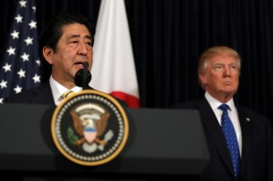 Japanese Prime Minister Shinzo Abe delivers remarks on North Korea accompanied by U.S. President Donald Trump at Mar-a-Lago club in Palm Beach, Florida U.S., February 11, 2017. REUTERS/Carlos Barria - RC1FD8CE5350