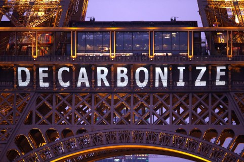 """Photo: The slogan """"Decarbonize"""" is projected on the Eiffel Tower as part of the World Climate Change Conference 2015 (COP21) in Paris, France, December 11, 2015. REUTERS/Charles Platiau - LR1EBCB1BVQ2S"""