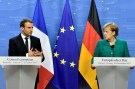 French President Emmanuel Macron and German Chancellor Angela Merkel give a joint news conference after the EU summit in Brussels, Belgium, December 15, 2017. REUTERS/Eric Vidal - RC149B2EE8A0