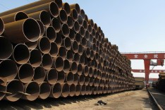Steel pipes waiting to be loaded and transferred to the port are seen at a steel mill in Cangzhou, Hebei province, China March 19, 2018. Picture taken March 19, 2018. REUTERS/Muyu Xu - RC1CB23F00A0