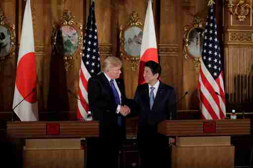 U.S. President Donald Trump, left, shakes hands with Shinzo Abe, Japan's prime minister, during a news conference at Akasaka Palace in Tokyo, Japan, November 6, 2017. REUTERS/Kiyoshi Ota/Pool - RC1C9C826580