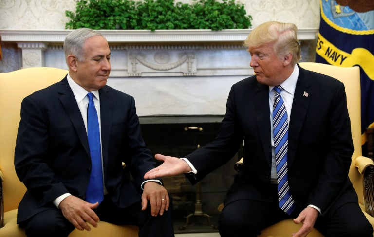 U.S. President Donald Trump meets with Israel Prime Minister Benjamin Netanyahu in the Oval Office of the White House in Washington, U.S., March 5, 2018. REUTERS/Kevin Lamarque - RC1912CE3760