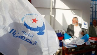 A supporter of the Islamist Ennahda Party holds a party flag during a municipal elections campaign in Tunis, Tunisia April 28, 2018. Picture taken April 28, 2018. REUTERS/Zoubeir Souissi - RC1319B67DE0