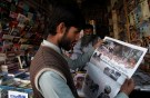 A man reads a newspaper's coverage of the attack on the Police Training College, at a newsstand in Quetta, Pakistan, October 26, 2016. REUTERS/Naseer Ahmed - S1AEUJDWITAA