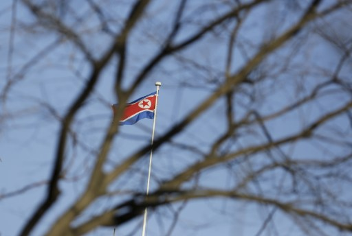 A North Korean flag is seen on the top of its embassy in Beijing, China, February 7, 2016. North Korea launched a long-range rocket on Sunday carrying what it has said is a satellite, South Korea's defense ministry said, in defiance of United Nations sanctions barring it from using ballistic missile technology. REUTERS/Jason Lee - GF10000298918
