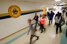 Students walk through the hallway during a class change at E.E. Smith High School.