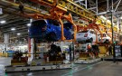 Automated Guided Vehicles carry the chassis for 2018 Chevrolet Sonic vehicles on the assembly line at General Motors Orion Assembly in Lake Orion, Michigan, U.S., March 19, 2018.  Photo taken March 19, 2018.   REUTERS/Rebecca Cook - RC1ED1C67090