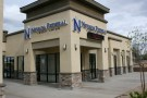 "The Nevada Federal Credit Union is seen with a sign reading ""for all."""