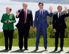 L-R: German Chancellor Angela Merkel, U.S. President Donald Trump, Canada's Prime Minister Justin Trudeau and French President Emmanuel Macron pose with other leaders (not pictured) for a family photo at the G7 Summit in the Charlevoix city of La Malbaie, Quebec, Canada, June 8, 2018. REUTERS/Yves Herman - HP1EE681F9O0Q