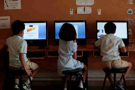 Students use computers in the technology lab at the Headstart private school in Pakistan