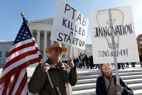 Protesters gather outside the Supreme Court, as the justices will hear arguments over whether a federal administrative process frequently used by high technology companies to invalidate patents they are accused of infringing violates the U.S. Constitution, in Washington, U.S., November 27, 2017. REUTERS/Yuri Gripas - RC1587F1F1B0