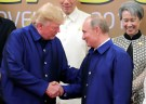 U.S. President Donald Trump and Russian President Vladimir Putin shake hands as they take part in a family photo at the APEC summit in Danang, Vietnam November 10, 2017. Sputnik/Mikhail Klimentyev/Kremlin via REUTERS ATTENTION EDITORS - THIS IMAGE WAS PROVIDED BY A THIRD PARTY.     TPX IMAGES OF THE DAY - RC18A81CDA80