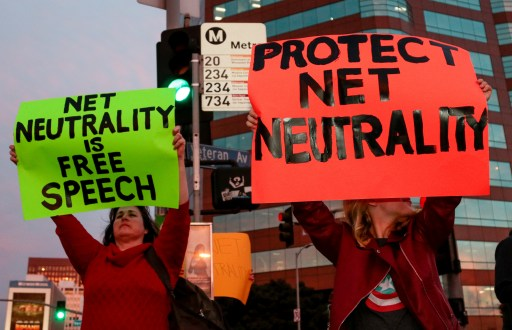 Supporter of Net Neutrality Ginger Gibson (L) of Valley Glen, California, protests the FCC's recent decision to repeal the program in Los Angeles, California, November 28, 2017. REUTERS/ Kyle Grillot - RC1DC22B8F50