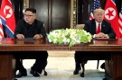 U.S. President Donald Trump and North Korea's leader Kim Jong Un hold a signing ceremony at the conclusion of their summit at the Capella Hotel on the resort island of Sentosa, Singapore June 12, 2018. Picture taken June 12, 2018. REUTERS/Jonathan Ernst - RC1D8AA662B0